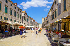 Main Street Scene, Dubrovnik. DUBROVNIK, CROATIA - JUNE 27, 2015: Scene of the main street (Stradun or Placa), with locals and tourists, in Dubrovnik, Croatia Royalty Free Stock Photos