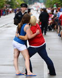 Main Street Selfie. These two young ladies decide to practice their selfies during the 4th of July, 2017 Parade in downtone Lexington, Ky USA Stock Images