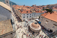 Main street Stradun full of tourists near church of St. Saviour and Big Onofrio`s fountain. DUBROVNIK, CROATIA - JULY 13, 2016: Main street Stradun full of Royalty Free Stock Images