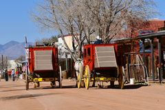 Main Street of Tombstone, Arizona. TOMBSTONE, ARIZONA, February 6, 2018: The red carriages parked on Main Street in downtown Tombstone AZ, a historic western Stock Photography