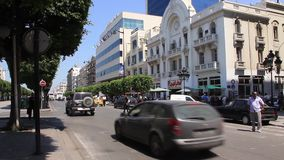 Main street of Tunis, Tunisia. TUNISIA, TUNIS, JUNE 30, 2010: Main street of Tunis, Tunisia, June 30, 2010 stock video footage