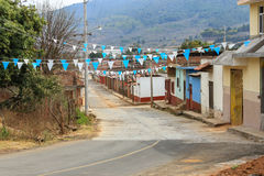 The main street of Tzintzuntzan in Mexico. A street in the Tarasco village of Tzintzuntzan, Michozacan, Mexico Stock Photos