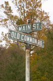 Main Street USA and Old Common Road sign in autumn, western Massachusetts, New England Royalty Free Stock Image
