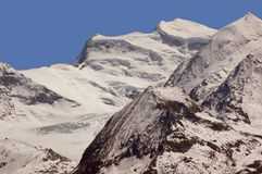 The main summit of the Grand Combin. (4314m) in the Swiss Alps, with the notoriously dangerous overhanging corniches Royalty Free Stock Photography