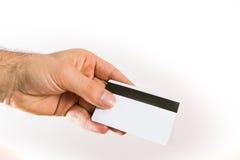 Main supportant une carte de crédit Photographie stock
