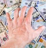 Main sur l'argent photographie stock
