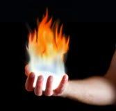 Main sur l'incendie Images stock
