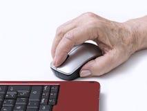 Main sur une souris Photographie stock libre de droits