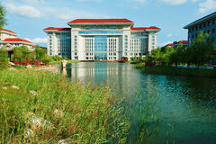 The main teaching building and lake. The photo was taken in colleges for training managerial personnel Sartu district Daqing city Heilongjiang province, China Stock Photography
