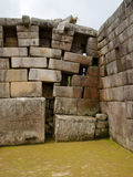 Main Temple at Machu Picchu, Peru. The back right corner of the Main Temple at Machu Picchu shows some damage caused by the settling ground. UNESCO World Royalty Free Stock Photography