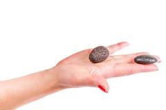 main tenant des pierres, thème de station thermale Images libres de droits