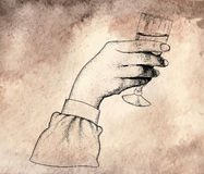 main tenant des verres de vin Photos stock