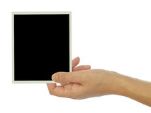 Main tenant le cadre vide de photo images libres de droits