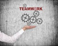 Main tenant le concept de travail d'équipe Image libre de droits