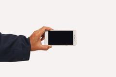 Main tenant le concept mobile de smartphone Images stock