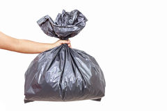 Main tenant le sac de déchets photos stock
