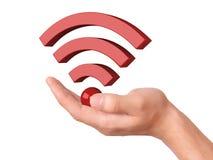 Main tenant le symbole de wifi sur le fond blanc Photographie stock libre de droits