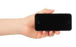 Main tenant le téléphone intelligent - iPhone d'Apple Photos stock