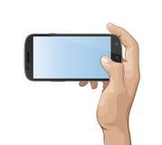 Main tenant le téléphone intelligent IV Image stock