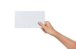 Main tenant un papier blanc Image libre de droits