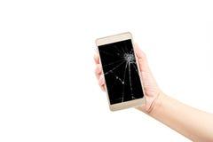 Main tenant un téléphone intelligent de couleur d'or Photographie stock libre de droits