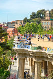Main terrace, Parc Guell, Barcelona, Spain. Main terrace with its undulating wall and tourists, Parc Guell, Barcelona, Spain, a popular public garden designed by Stock Images