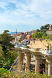 Main terrace, Parc Guell, Barcelona, Spain. Main terrace with its undulating wall and tourists, Parc Guell, Barcelona, Spain, a popular public garden designed by Royalty Free Stock Photography