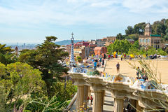 Main terrace, Parc Guell, Barcelona, Spain. Main terrace with its undulating wall and tourists, Parc Guell, Barcelona, Spain, a popular public garden designed by Stock Photography