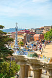Main terrace, Parc Guell, Barcelona, Spain. Main terrace with its undulating wall and tourists, Parc Guell, Barcelona, Spain, a popular public garden designed by Royalty Free Stock Images
