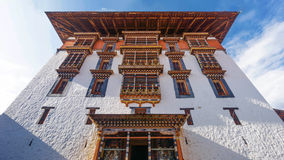 The main tower for prayer with asian art window and roof at Paro Dzong, Bhutan. PARO BHUTAN MARCH 02 2016 :the main tower for prayer with asian art window and Stock Photo