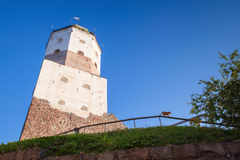 Main tower of Vyborg Castle with tourists on roof Royalty Free Stock Photography