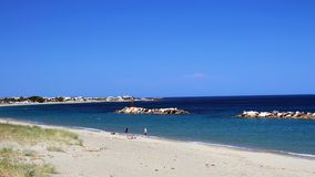 Chora Beach, Skyros Greek Island, Greece. The main town beach, or Chora Beach, on Skyros, a Sporades Greek Island, with clear blue sky, rock formations in clear Royalty Free Stock Photography