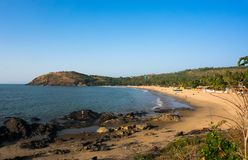 The main town beach of Gokarna, India, a lot of yellow sand and few people. The evening Stock Photo