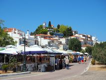 Skiathos Town, Aegean Greek Island, Greece. The main town of Skiathos, an Aegean Greek Island, Greece, with shops, cafes, tavernas and restaurants, and a Greek stock images