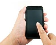 Main utilisant le téléphone intelligent Photos stock