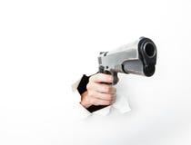 Main venant par le trou avec le grand canon Photographie stock libre de droits