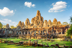 Main view of ancient Bayon temple in Angkor Thom, Cambodia. Main view of ancient Bayon temple in Angkor Thom in evening sun. Mysterious Angkor Thom nestled among Royalty Free Stock Photography