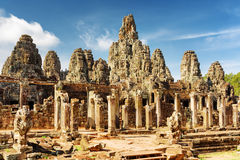 Main view of ancient Bayon temple in Angkor Thom, Cambodia. Main view of ancient Bayon temple in mysterious Angkor Thom on blue sky background. Siem Reap Stock Images