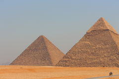 Main view of Giza's two largest pyramids with Cairo city in background Royalty Free Stock Photo