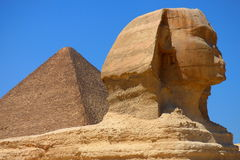 Main view of the Great Sphinx of Giza with Pyramid backwards, Egypt.  Royalty Free Stock Photo