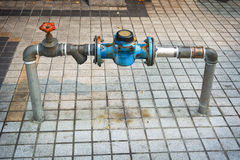 Main Water Line with Meter and Valve on Public Sidewalk Stock Photo