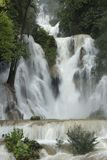 Main waterfall in Kuang Si waterfalls near Luang Prabang vertical stock photo