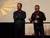 Mainactor Rain Tolk l and Director Andres Maimik r  at the Internationales Filmfestival Mannheim-Heidelberg 2017. Mannheim/Heidelberg, Germany, 2017-11-11 Royalty Free Stock Images