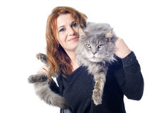 Maine coon cat and woman. Portrait of a purebred  maine coon cat and woman on a white background Royalty Free Stock Images