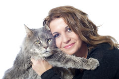 Maine coon cat and woman. Portrait of a purebred  maine coon cat and woman on a white background Stock Photo