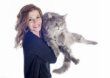 Maine coon cat and woman. Portrait of a purebred  maine coon cat and woman on a white background Stock Photography