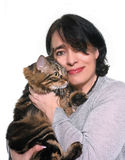 Maine coon cat and woman. In studio Royalty Free Stock Images
