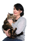 Maine coon cat and woman. In studio Stock Image