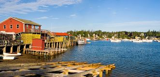 Maine fishing harbor panorama. A beautiful early morning view of a Maine fishing pier and lobster boats at anchor in Bass Harbor, Maine Stock Photo