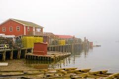 Maine fishing wharf in fog stock photography